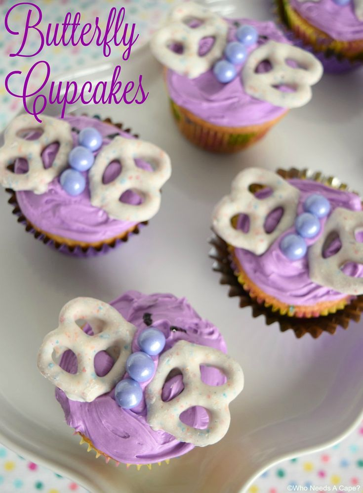 Butterfly Cupcakes =  White Chocolate Covered Pretzels with Sprinkles with M & Ms for the Body