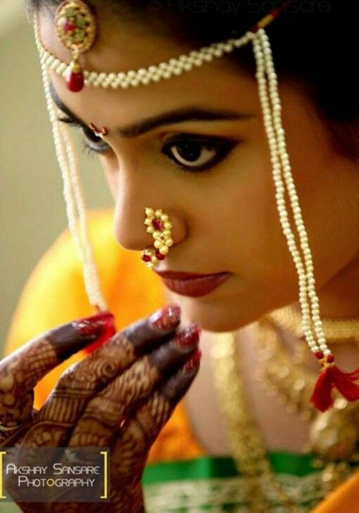 Traditional Indian Maharashtrian bride wearing bridal silk saree, jewellery and hairstyle. Nath. Nose pin. Hindu bride. Indian Bridal Makeup. Indian Bridal Fashion.