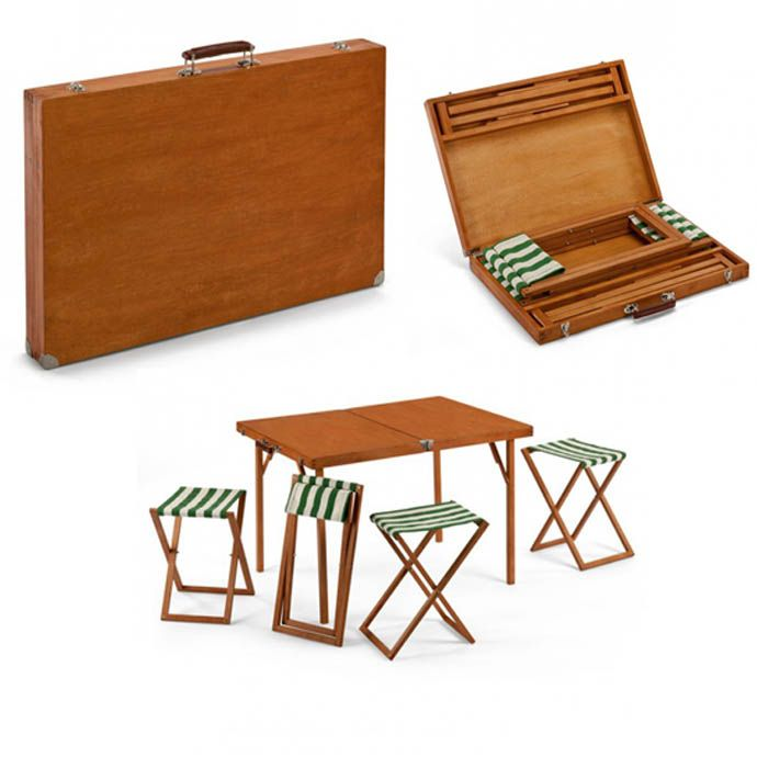Picnic Table: Eat and Go :::    Who doesn't enjoy a picnic on a summer day. Now it's easier than ever with this stow away briefcase. Inside of this wood and metal rimmed briefcase is a folding table-and-stool set. So why bring blankets and sheets when you can be sitting poshly in these chairs.