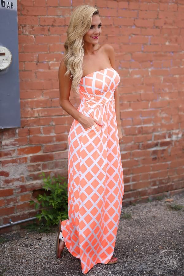 Our best-selling maxi dress style in a fun new print! Neon coral diamond print, strapless maxi dress with ruched banded waist and pockets. Unlined. Made in the USA! Stylist Suggestion: Backless Sticky