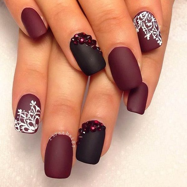 Beautiful matte black and maroon nail art design. The matte polish makes the design pop out even more as the lace designs can be more noticeable.
