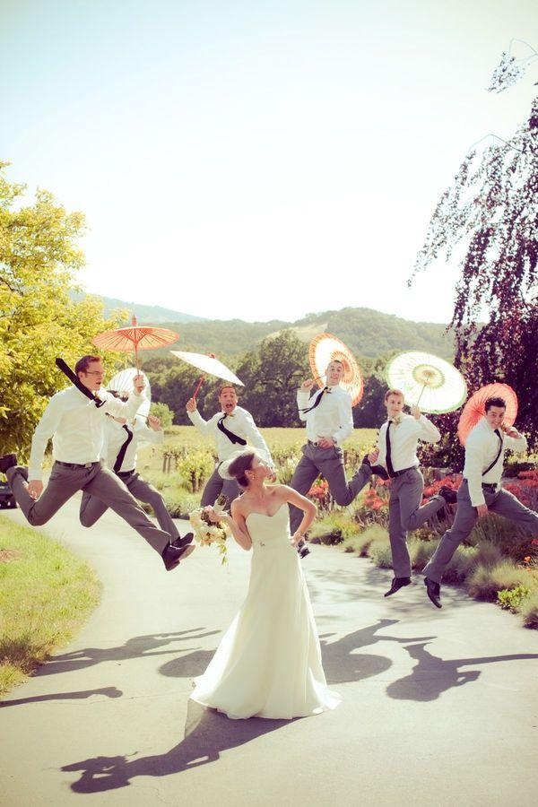 wedding photo shoot with pink and yellow wedding umbrellas