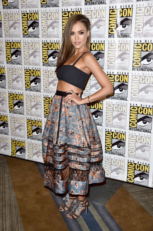 Jessica Alba wearing Tanya Taylor cropped black bandeau top and a billowing Zimmerman printed skirt with mesh panelling, accessorised with mirrored and tasseled Kotur 'Guzel' heels @ Comic-Con 2014