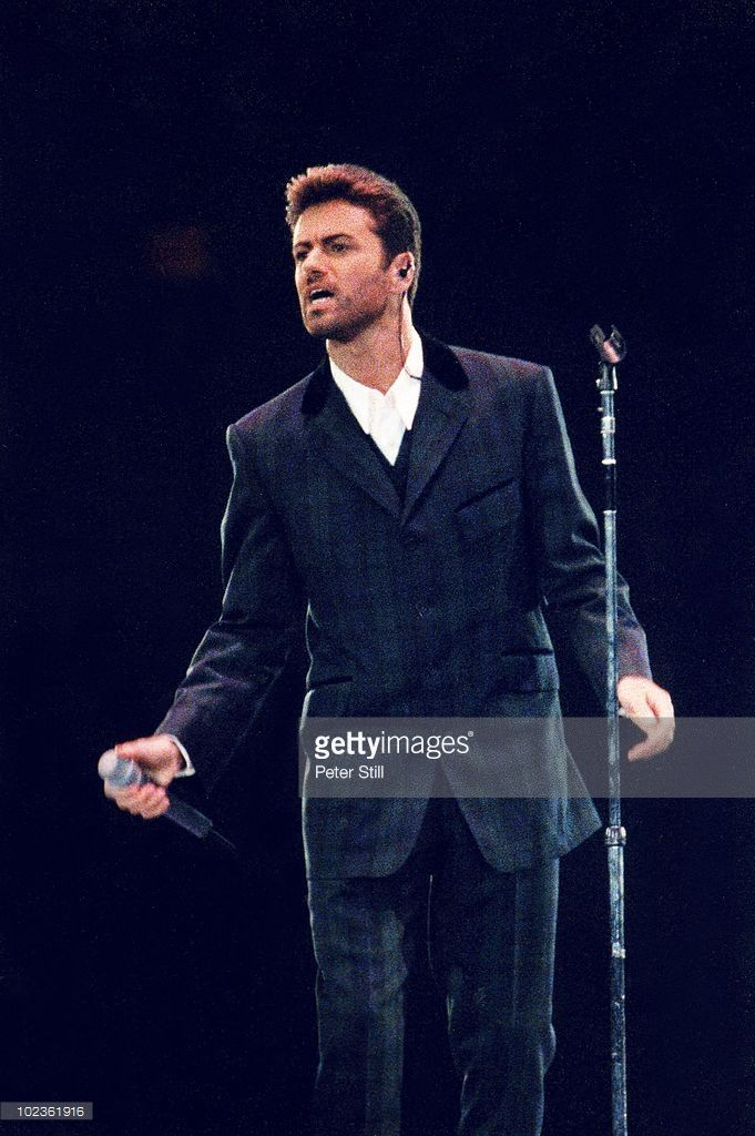 George Michael performs on stage at the 'Concert Of Hope', in Wembley Arena on December 1st, 1993 in London, England.