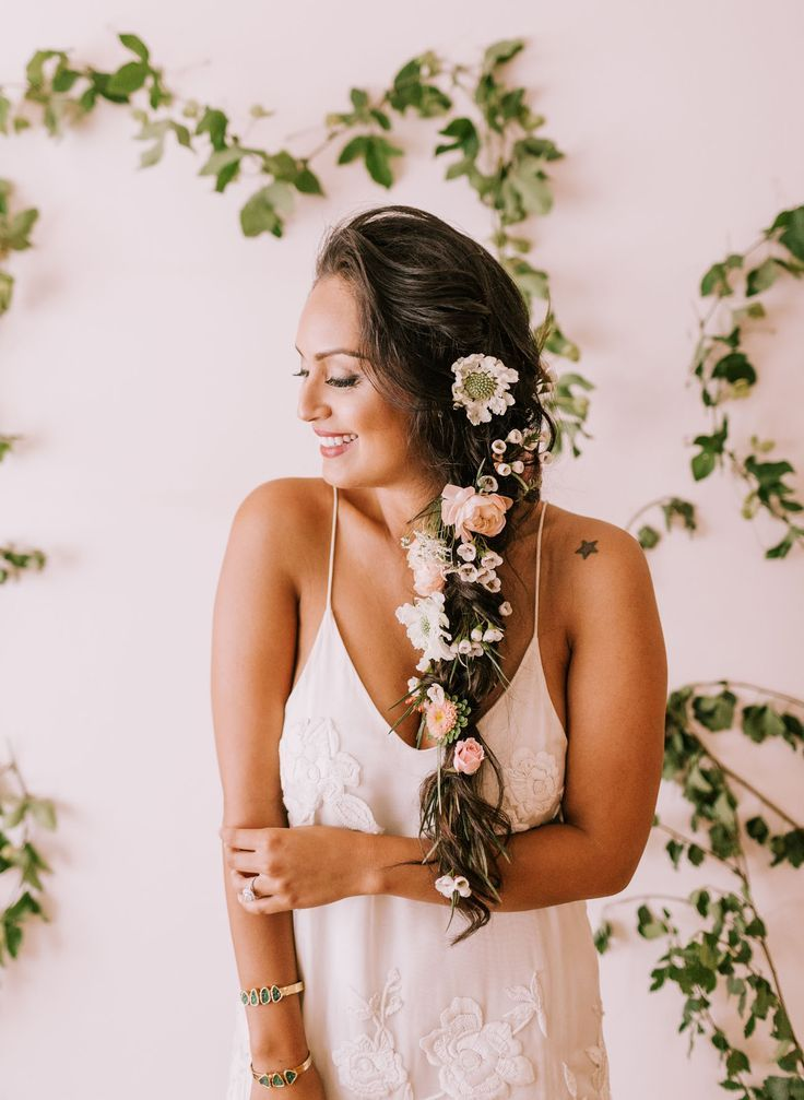 For the boho bride this loose braid with florals is perfect