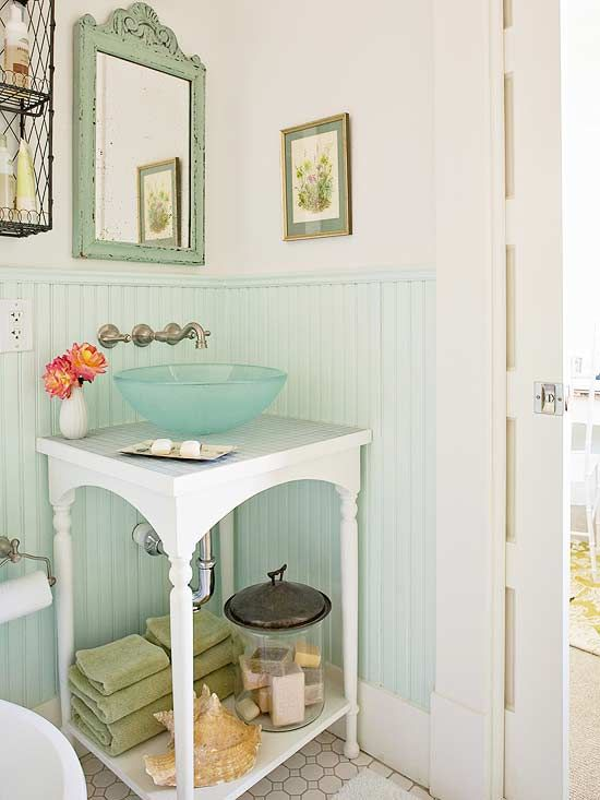 Small and Sweet bathroom--Small and Sweet bathroom  PREV  24/26  NEXT  Small and Sweet        New and salvaged materials come together to create this adorable, one-of-a-kind vanity. A vanity with a small frame was needed to conserve space in this tiny half bath. The base is topped off with glass mosaic tile and a glass basin. The simple open bottom offers a single shelf that can easily hold towels, a jar of soaps, and a large decorative seashell.