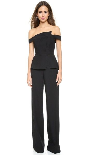 Black Halo La Reina Strapless Jumpsuit with tiered panels in black.