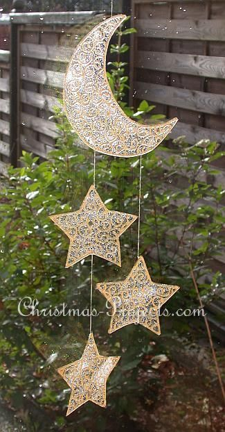 Moon and stars.I want to make this out of old lace curtains or doilies using fabric stiffener adding glitter before it hardens