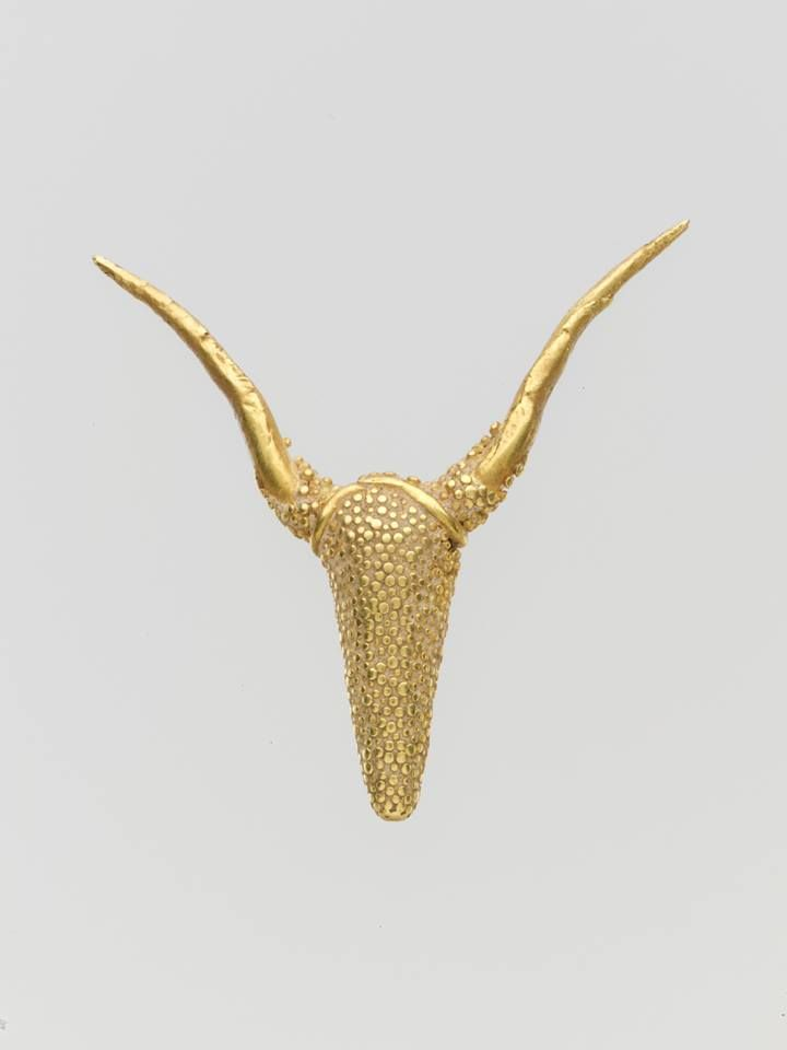 Gold pendant with granulated ornament. Period: Late Bronze Age Date: ca. 1400-1050 B.C.E. Culture: Cypriot. The oldest evidence of a cult of the bull can be traced back to Neolithic central Anatolia, notably at the sites of Çatalhöyük and Alaca Höyük. Bull depictions are omnipresent in Minoan frescos and ceramics in Crete. Bull-masked terracotta figurines and bull-horned stone altars have been found in Cyprus ,dating back as far as the Neolithic.