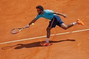 Tsonga saunters into semis in Lyon Raonic joins him