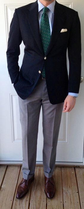 Navy blazer, light blue shirt, green tie with white tie, light grey pants