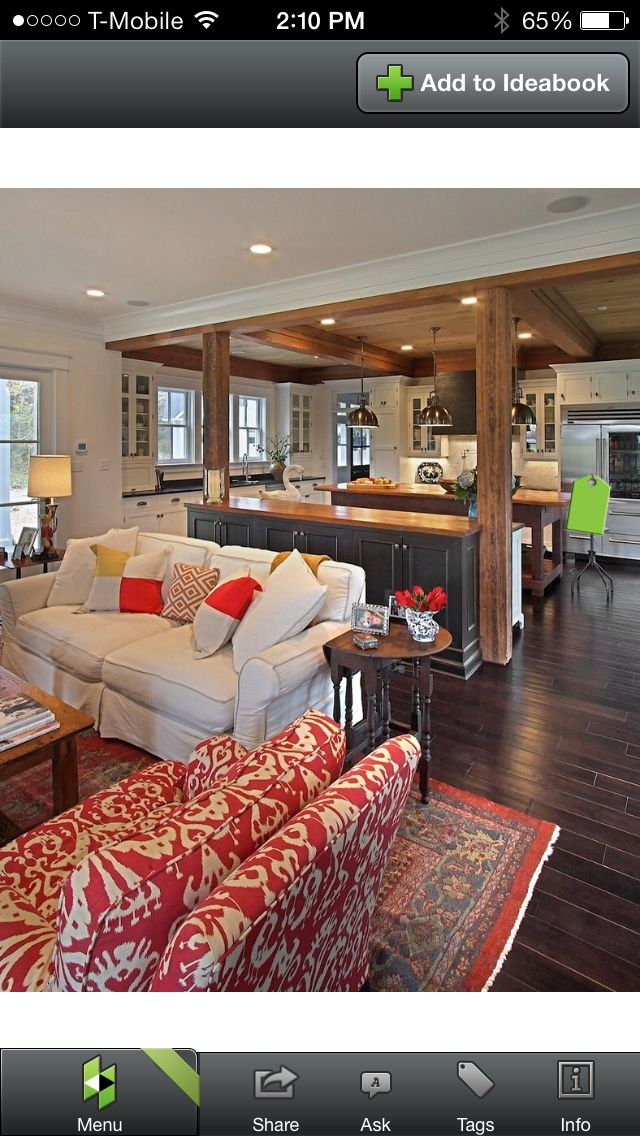 Transition between rooms when one has a flat ceiling and the next has beams