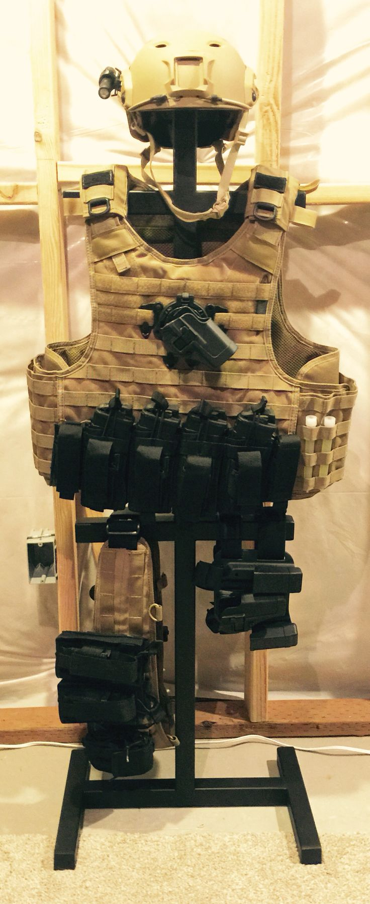 Built myself a Tactical Gear Tree. It looks awesome but more importantly if keeps my gear organized and off the floor.
