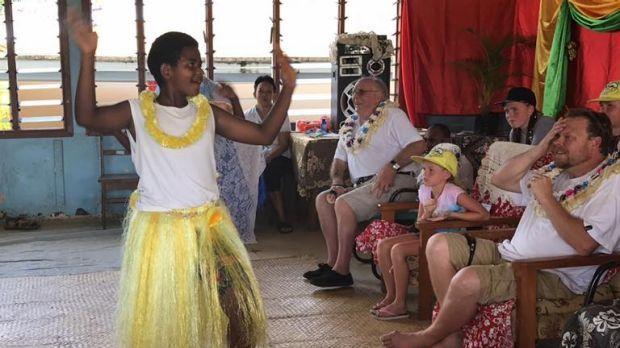 Namalata District School students welcome Bonython Primary School representatives to their village in Fiji.