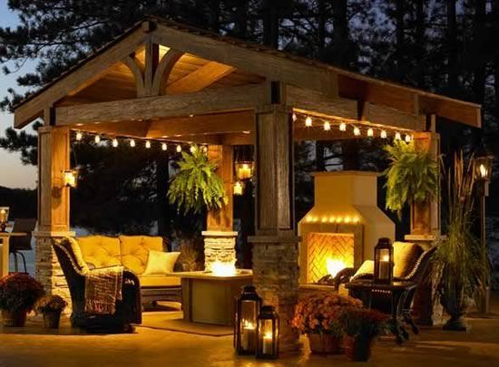A fireplace AND a fire pit? Make the fire pit ground level--gives it an authentic 'camp fire' feel. Then replace the fireplace with an outdoor kitchen.