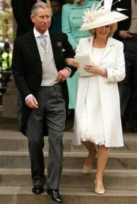 The marriage of Prince Charles of England and Camilla Parker-Bowles - April 9, 2005.    For the civil ceremony at the Windsor Guildhall, Camilla wore an oyster silk basket-weave coat with herringbone stitch embroidery and a chiffon dress with appliqué woven lacquered discs which were made in Switzerland.    The outfit was by British designers Robinson Valentine. The Duchess of Cornwall wore a natural straw hat overlaid with ivory French lace and trimmed with a fountain of feathers, desig