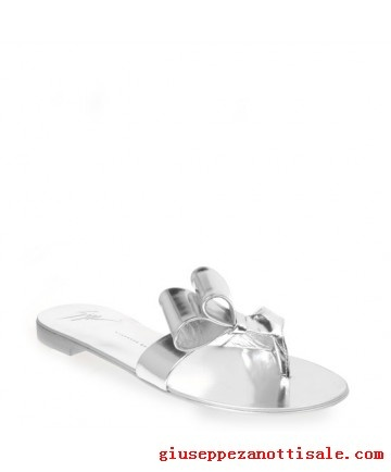 giuseppe-zanotti Flip Flops Shoes for Women silver mirror-effect Flat thong sandals in silver mirror-effect calfskin. The simple, clean design is embellished with a jaunty, lopsided bow. These sandals are an easy solution any time of day.