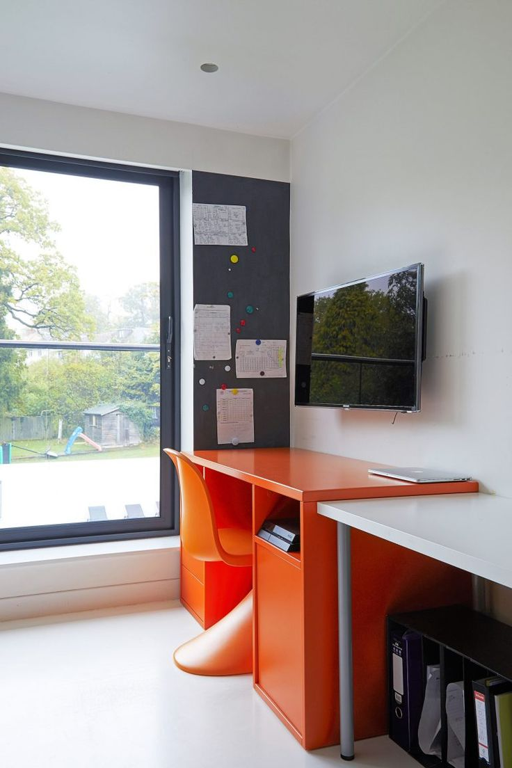 Orange study desk for a teenager. Icon, London, NW7 - Ultra-Contemporary Location House - SHOOTFACTORY