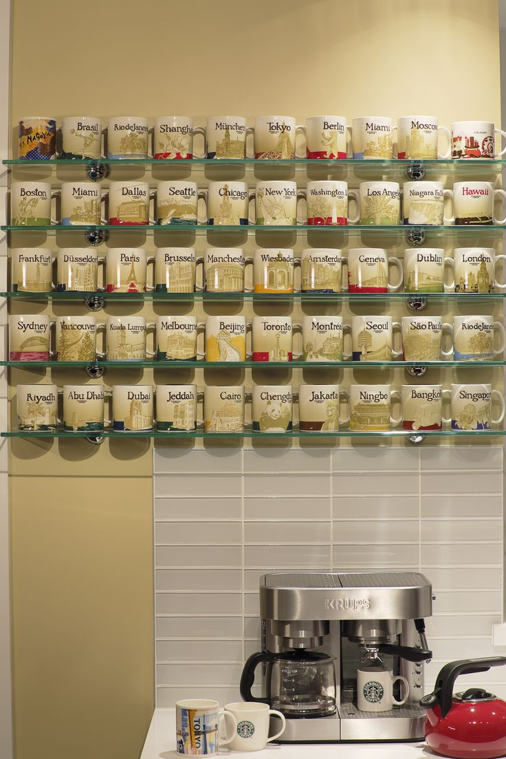Glass Shelves showcasing Starbucks City Mugs Collections.