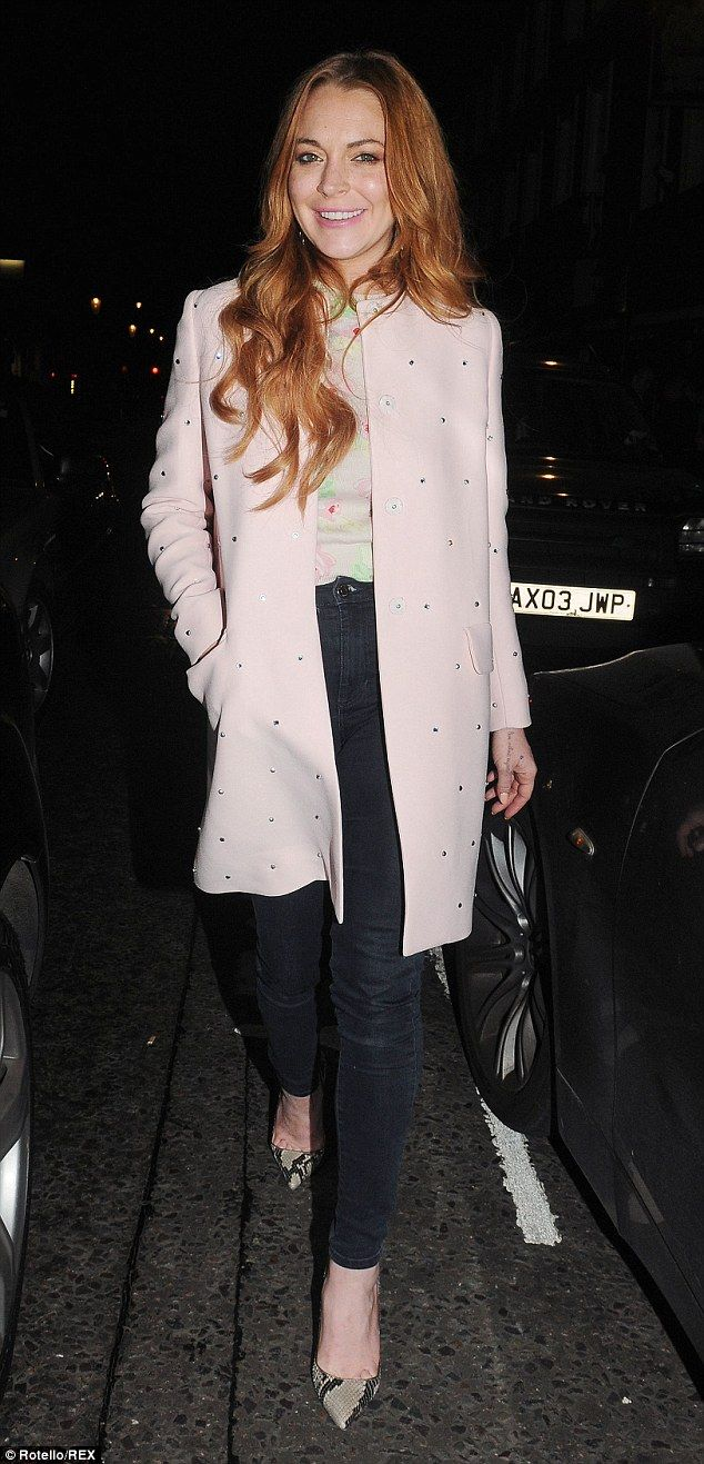 Simply chic: Lindsay Lohan opted to enjoy a lovely dinner with friends as she was pictured out and about on Friday night in London