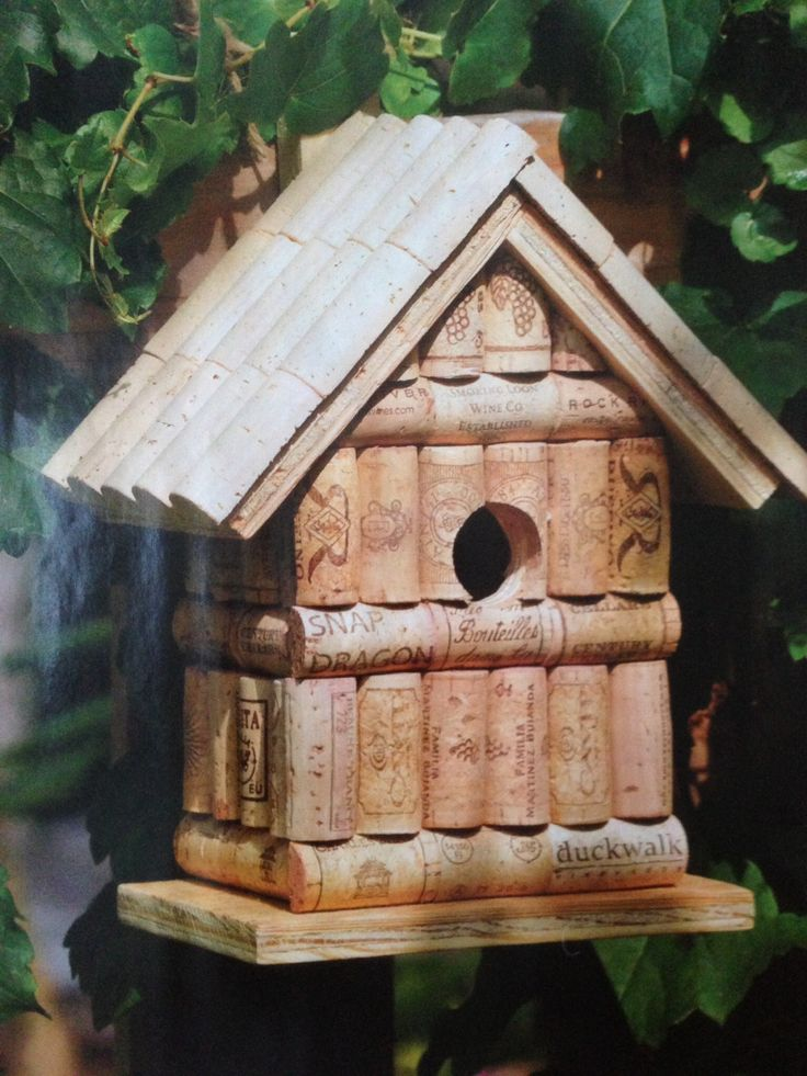 Wine cork birdhouse from Birds & Blooms magazine. Just glue 1/2 corks on pre-made house