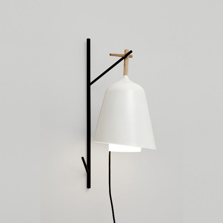 Under my tree lamp: Florian Brillet for Ligne Roset.approached by ligne roset to design a garden lamp, florian brillet created a portable version which can easily be hung on tree branches.'the choice of portable lamp is quite pragmatic as it is the most adaptable to all situations. it can be hung, held or moved to where it is required. 'sous mon arbre' is an invitation to dine outside, an object conducive to conviviality,' says brillet.