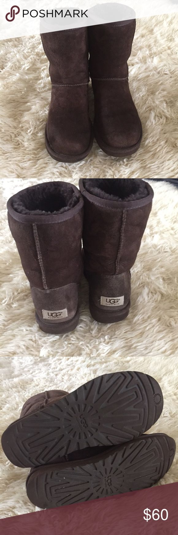 Brown Classic short UGGS Classic brown short UGGS boots.  Size 7.  Good condition( normal wear on front) pet/smoke free home UGG Shoes Winter & Rain Boots