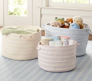 Another great idea for toys in the nursery- no chance of falling over or sharp corners  Round Woven Storage #PotteryBarnKids
