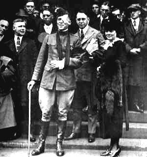 """""""Chicago Tribune"""" World War I war correspondent Floyd Gibbons welcomed home in Minneapolis, MN. His sister Zelda is at his left. At the Battle of Belleau Wood, France, Gibbons lost an eye after being hit by German gunfire while attempting to rescue an American soldier."""