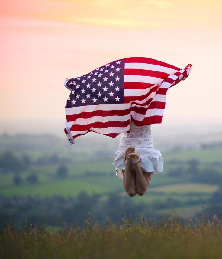 Jumping with the US Flag by Sasha L'Estrange-Bell