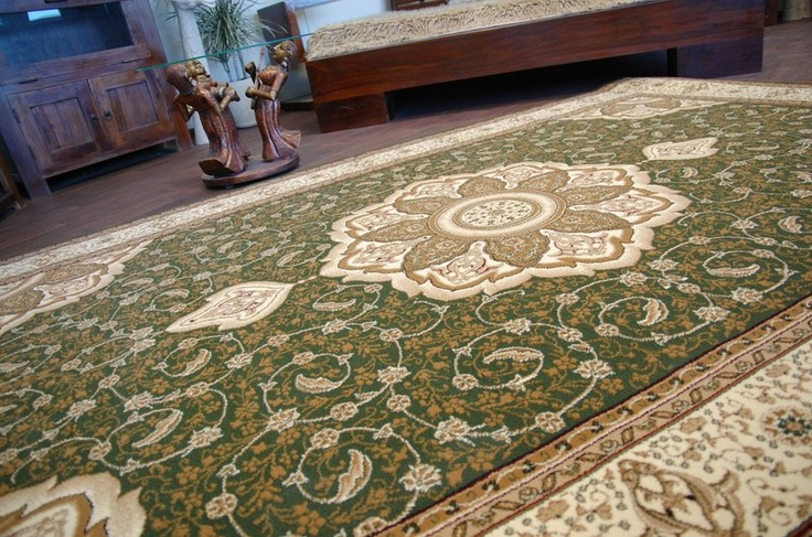 Green area rugs like this one will bring a calm, earthy vibe to a room.