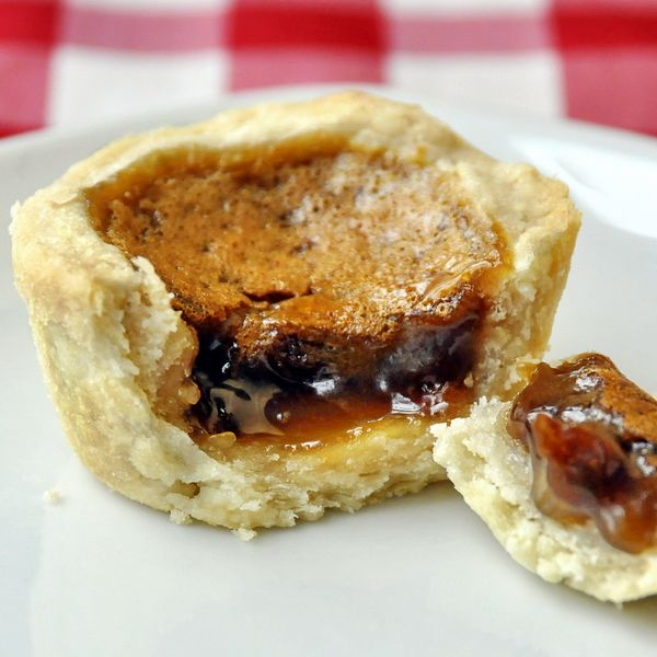 Classic Canadian Butter Tarts are near the top of my personal list of can't resist baked treats. The sweet, caramelly filling with a thick super flaky pastry just makes for one tart I cannot say no to under any circumstance. I like raisins in mine too but you can also use pecans, walnuts or even chocolate chips. Irresistible!