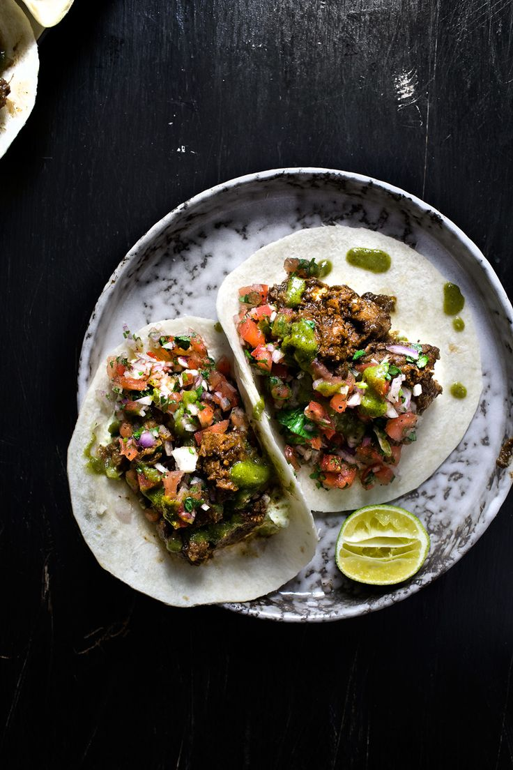 Jerked-up sriracha roast pork tacos, with avocado and sour cream mash, and kiwi salsa verde