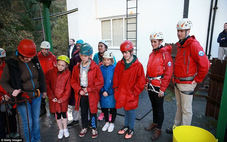 Kate and William listen to a briefing as they prepare to abseil as they visit the Towers R...