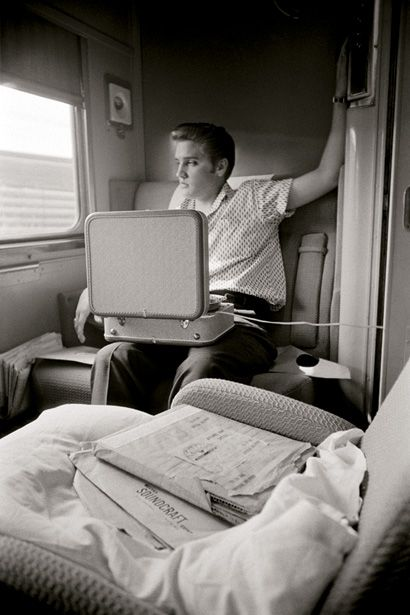 Elvis on the train from New York to Memphis, listening on a cheap portable record player to acetate cuts of the songs he had recorded the da...