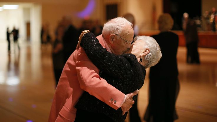 Donald Smitherman, 98, kisses his wife Marlene at the end of a dance in Sun City, Arizona, January 5, 2013. Sun City was built in 1959 by entrepreneur Del Webb as America?s first active retirement community for the over-55's. Del Webb predicted that retirees would flock to a community where they were given more than just a house with a rocking chair in which to sit and wait to die. Today?s residents keep their minds and bodies active by socializing at over 120 clubs with activities such as…