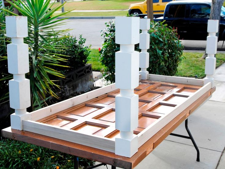 HGTV.com+shows+how+to+reuse+an+old+door+and+balusters+by+turning+them+into+a+new+dining+table.+
