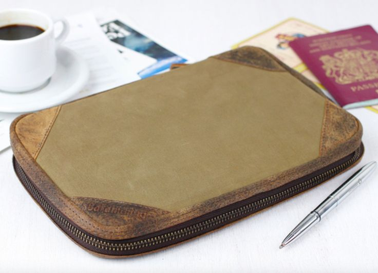 Our khaki canvas travel organiser will carry all travel documents for you, family, partners or friends. #canvas #travel #leather #travelessentials