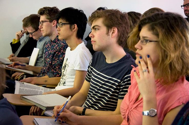 """Students listen to a lecture on Plato's """"Republic"""""""