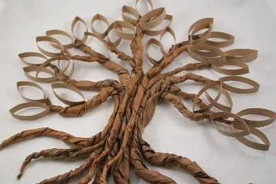 Toilet Paper Roll Artwork | it is made from brown paper bags and paper towel holders