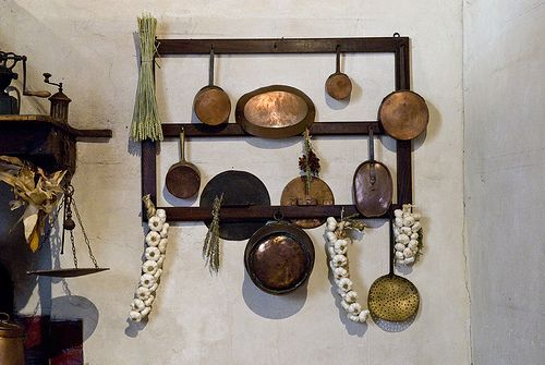 Copper Pots, garlic and herbs hanging on a kitchen wall in Tuscany by jackie weisberg, via Flickr