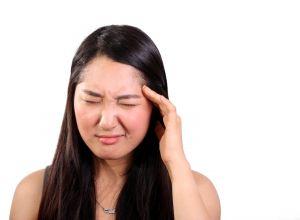 Women with headache wishing she had some ice.