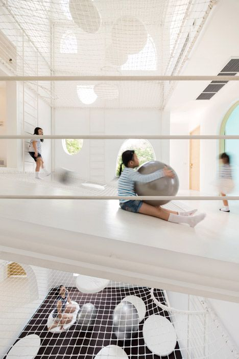 Holiday house is giant playground with layers of nets - inspired by holey cheese in cartoons