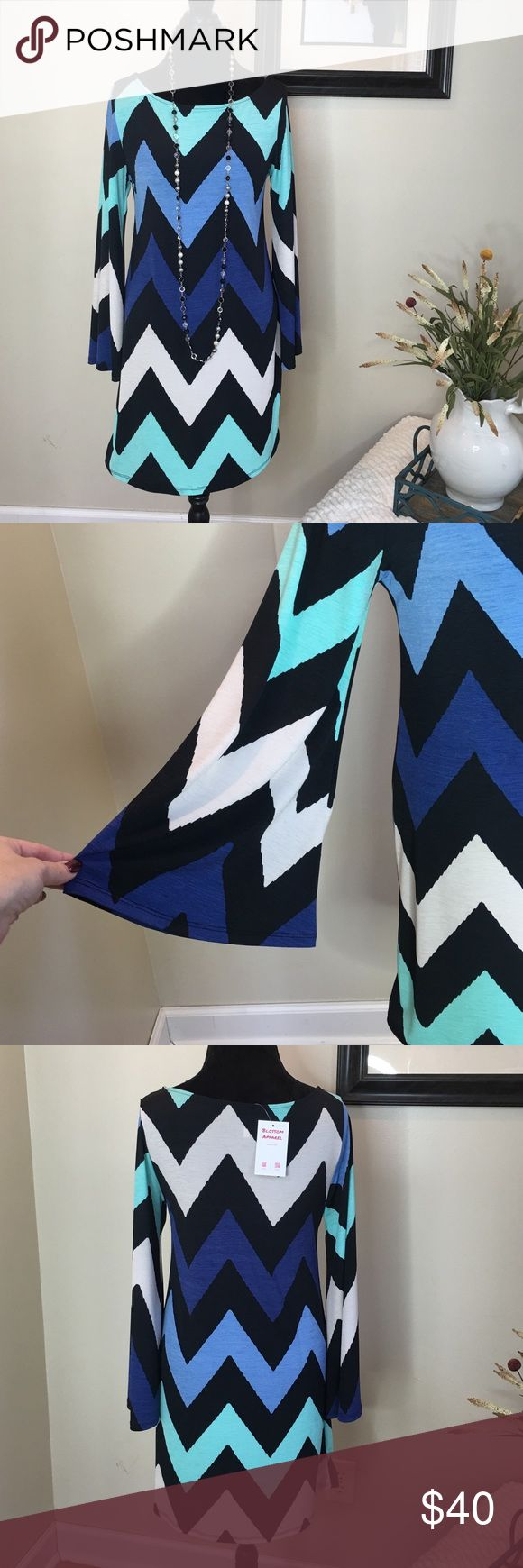 Chevron print wide sleeve dress Chevron print wide sleeve dress. 100% made in the USA!! 95% polyester and 5% spandex. Quality made dress!!! The Blossom Apparel Dresses Midi