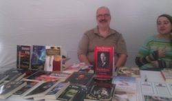 Five Rivers display at Word on the Street (Lethbridge). In addition to the table display, Five Rivers co-sponsored a free Bluepencil Café with the local Editors Canada twiglet, and SFeditor.ca. Pictured here is Senior Editor Robert Runté and author Barb Geiger, a former 5R staffer who took part in the blue pencil café.