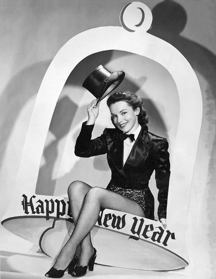 A woman tips her hat to the New Year | 1950 | #vintage #1950s #newyear