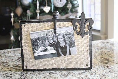 "DIY picture ""displayers"" made from a 2x8, burlap, spray paint, clothes pin, a few misc. cute things, and tacks. whoop! totally doing this todayyy"