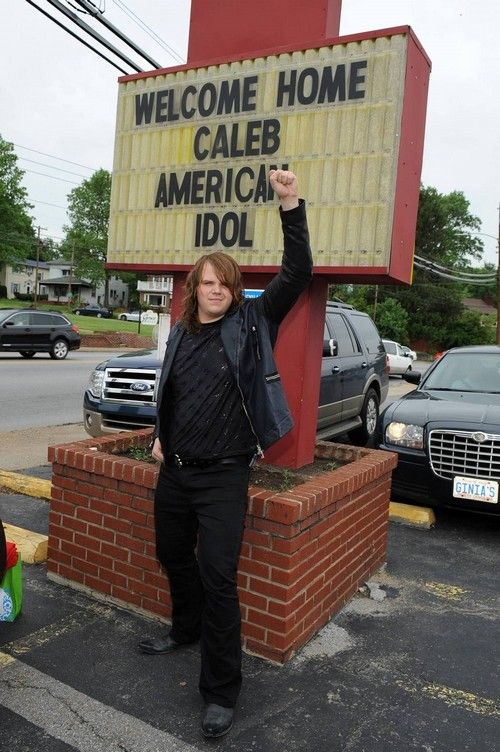 """WNC's Caleb Johnson  """"American Idol' standing in front of Happy Hill resaurant in West Asheville."""