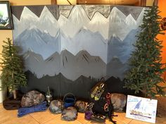 Falls Church Everest display! Painted mountains on refrigerator box. Rocks are made from newspaper and flour water and spray painted. Climbing gear from Sioux Falls Climbing Club.