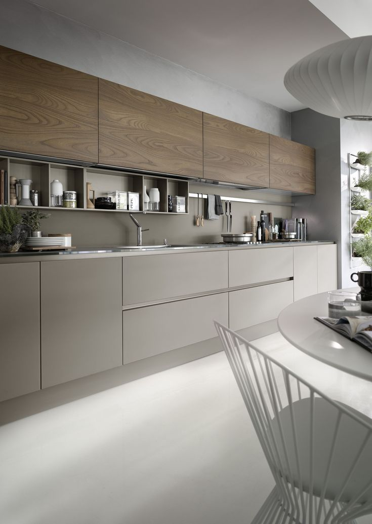 """System Collection is a modern kitchen that is easy and only creates light barriers between the living areas. This model distinguishes itself by coupling technology with natural materials while the visible structures support, organize and contain, the worktop extends like a real working surface. This while the geometric shapes, with essential lines and generous dimensions, create a refined and contemporary """"oasis"""", with a trenchant and luxury personality, dedicated to living in the kitchen."""